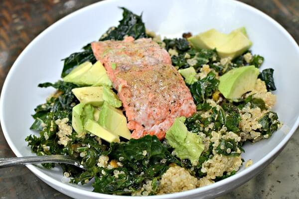 Kale and quinoa salad with avocado and leftover salmon.