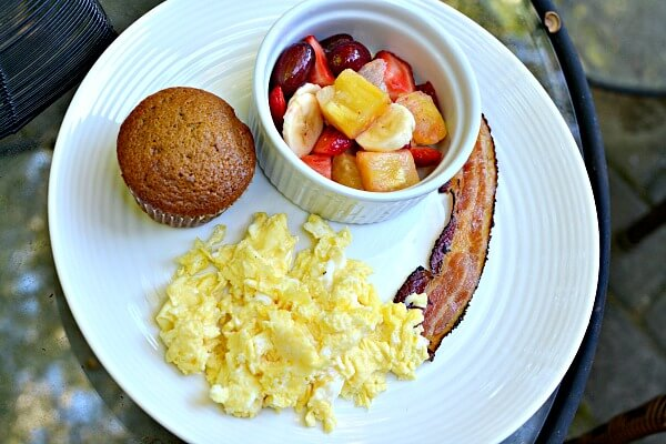 sunday brunch - pumpkin muffins with scrambled eggs, bacon and fruit salad