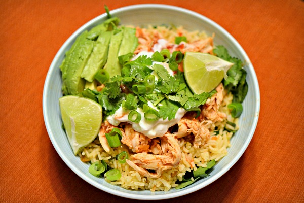 leftover shredded rotisserie chicken breast tossed with salsa and served over a bed of spinach and cilantro-lime rice. Topped with a spoonful of plain greek yogurt, avocado, cilantro, green onions and lime wedges.
