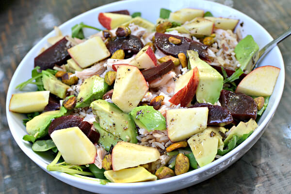 Arugula, leftover rice, apples, shredded chicken breast, pistachios, beets . and avocados with Tessemae's Green Goddess dressing.