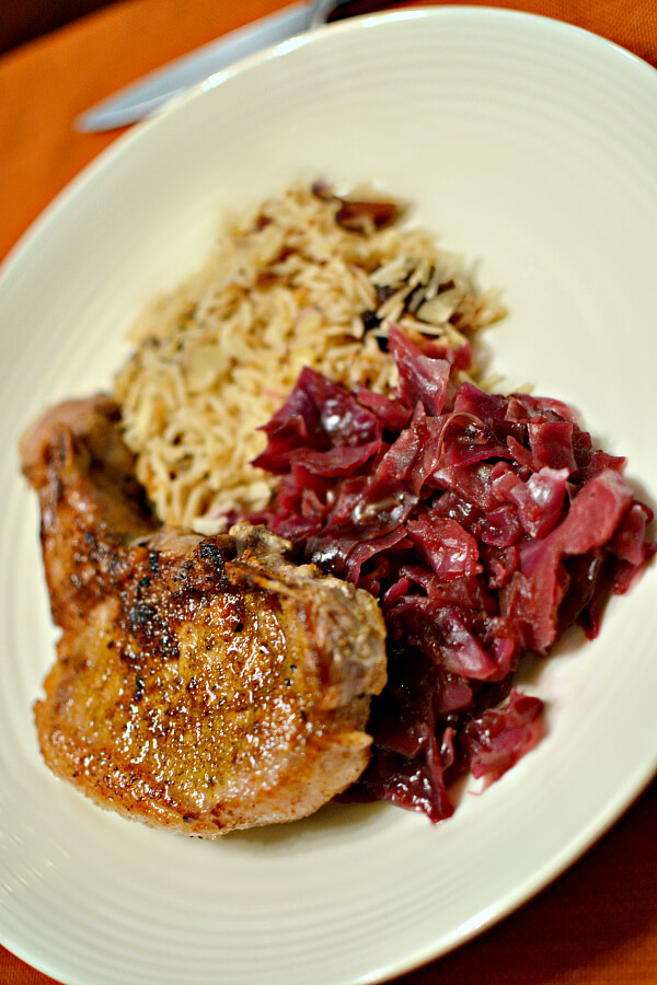 sauteed pork chops with braised red cabbage and jeweled rice