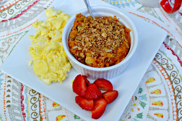 sweet potato breakfast bowl with scrambled eggs and strawberries