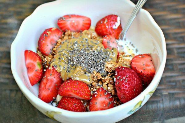 plain greek yogurt with honey, bananas, strawberries, granola, sunflower seed butter and chia seeds