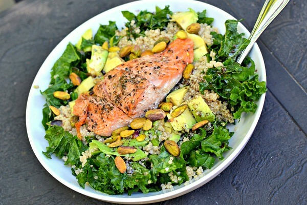 Massaged kale with quinoa, pistachios, avocado, salmon and Tessemae's green goddess dressing.