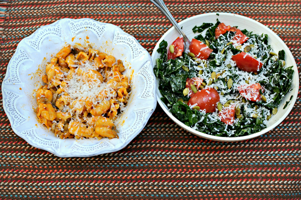 Leftover pasta with a kale salad with tomatoes, pumpkin seeds, parmesan and simply caesar dressing.