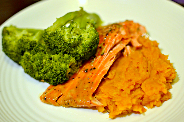 wild Alaskan salmon with steamed broccoli and sweet potatoes.