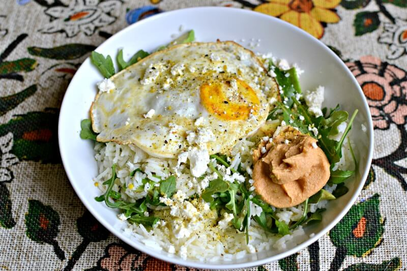 basmati rice, arugula, avocado, feta, srircha hummus and a fried egg
