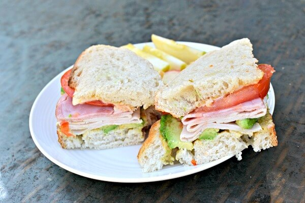 sourdough with mayo, mustard, tomato, muenster, ham, turkey and avocado