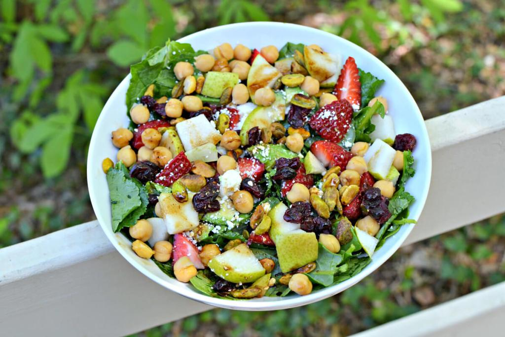 baby kale salad with fruits and nuts