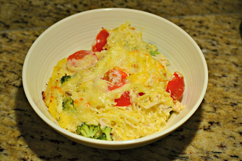 spaghetti squash with chicken, broccoli, tomatoes and cheese