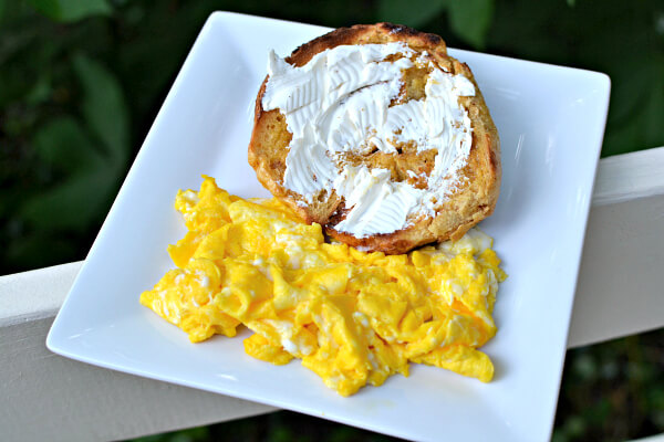 bagel with cream cheese and scrambled eggs