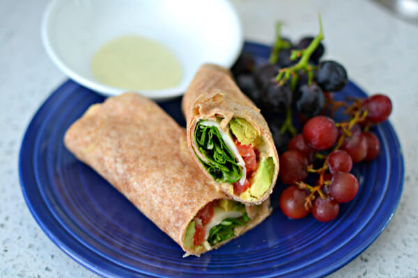 Sprouted whole wheat wrap with hummus, avocado, tomatoes, provolone and arugula. Dipped in an avocado ranch dressing.