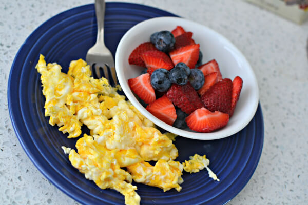 Scrambled eggs and fresh fruit