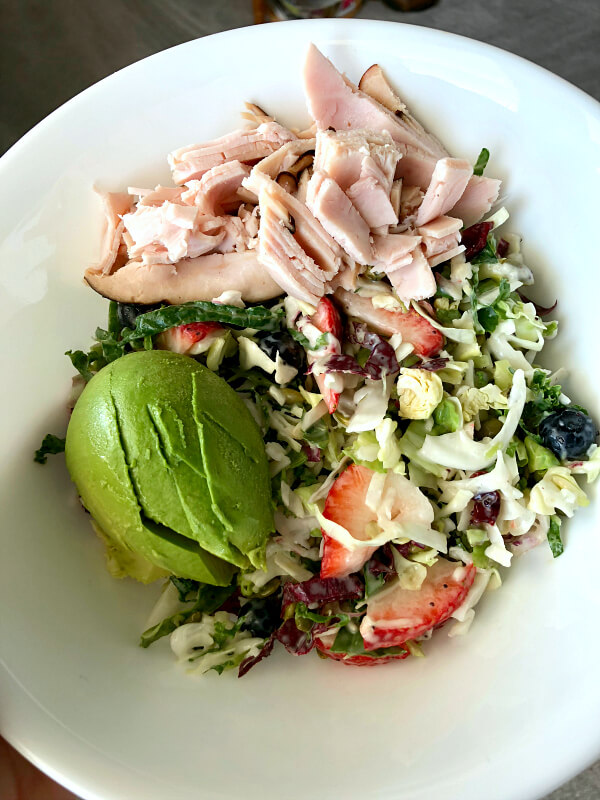 kale salad with avocado, turkey and berries