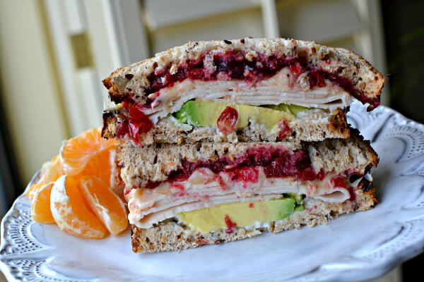turkey and avocado sandwich on Dave's Killer Bread Good Seed with pepper jack and cranberry sauce
