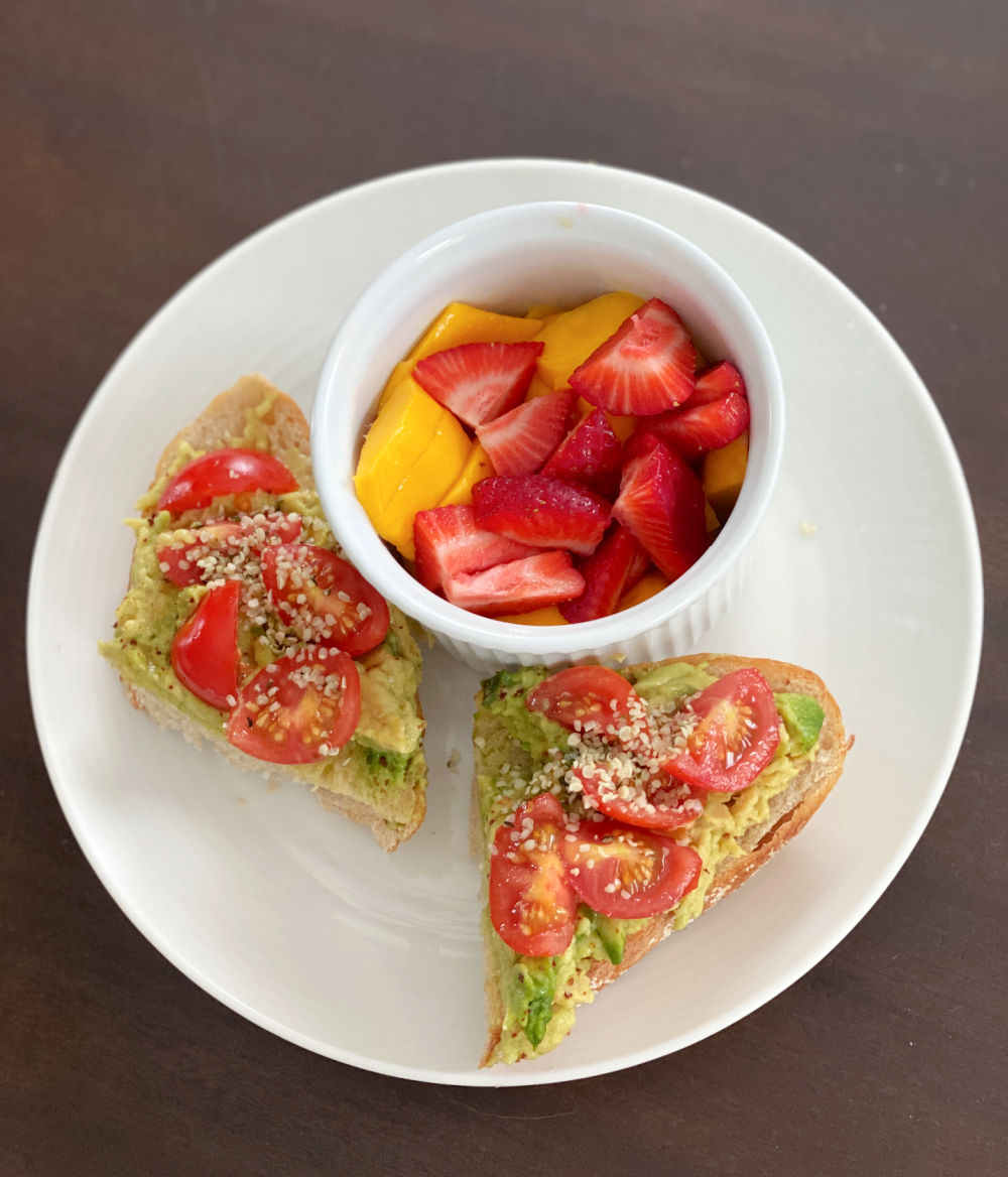 avocado toast with tomatoes and chili lime seasoning