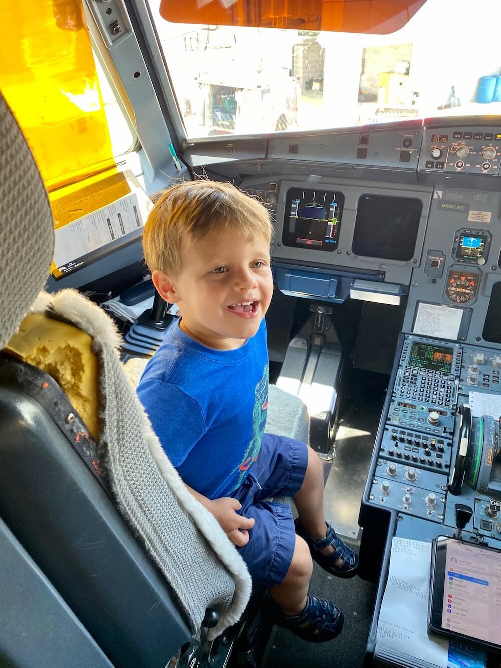 toddler in cockpit