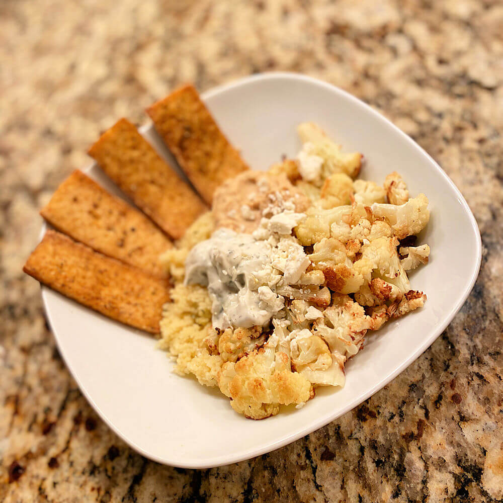 air fried tofu with couscous and roasted cauliflower