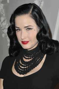 dita von teese wearing a black necklace