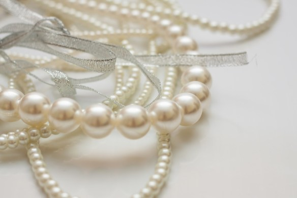 photo of rows of cultured pearls (white)