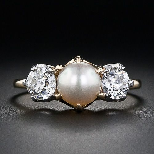 antique wedding ring with medium sized pearls