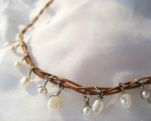 white pearls on leather string