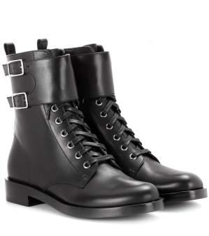 black shoes combat black leather boots