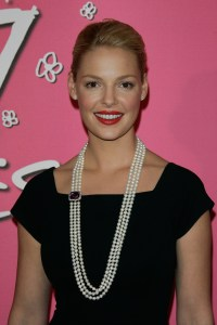 Katherine Heigl wearing a white triple strand pearl necklace