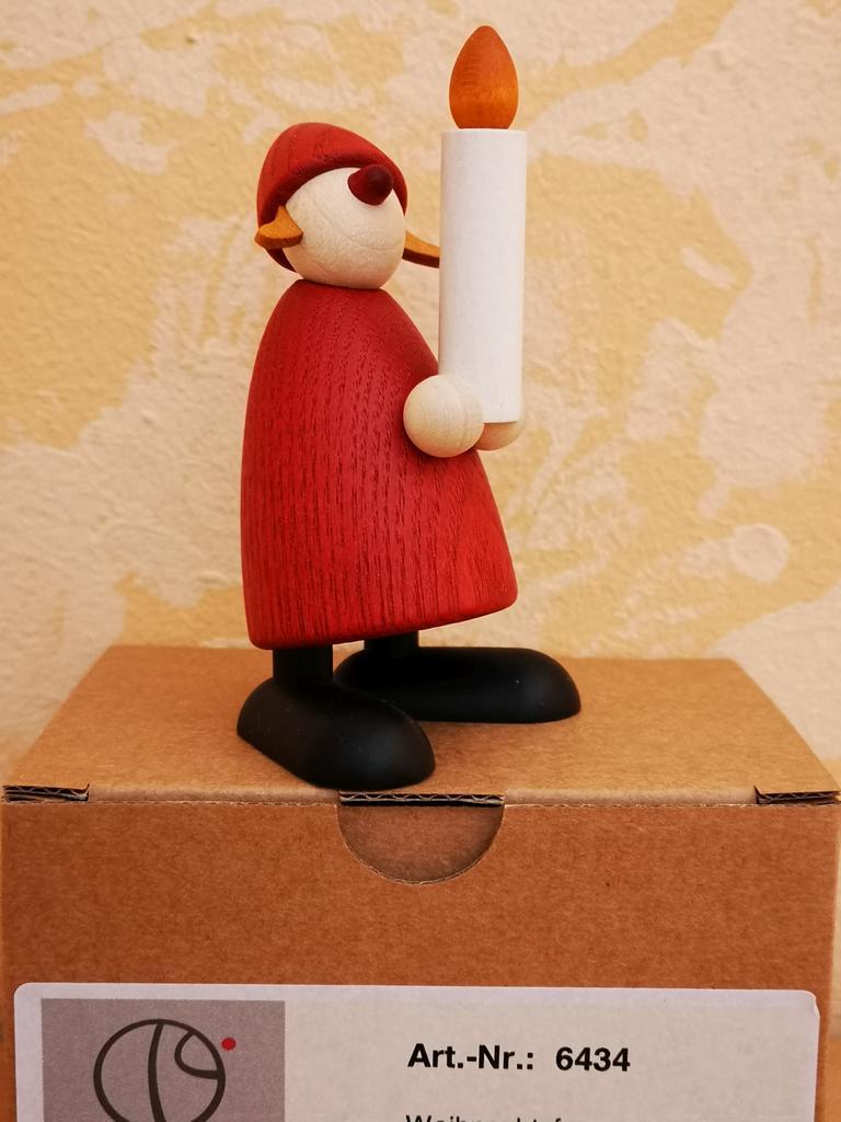 Weihnachtsfrau mit Kerze