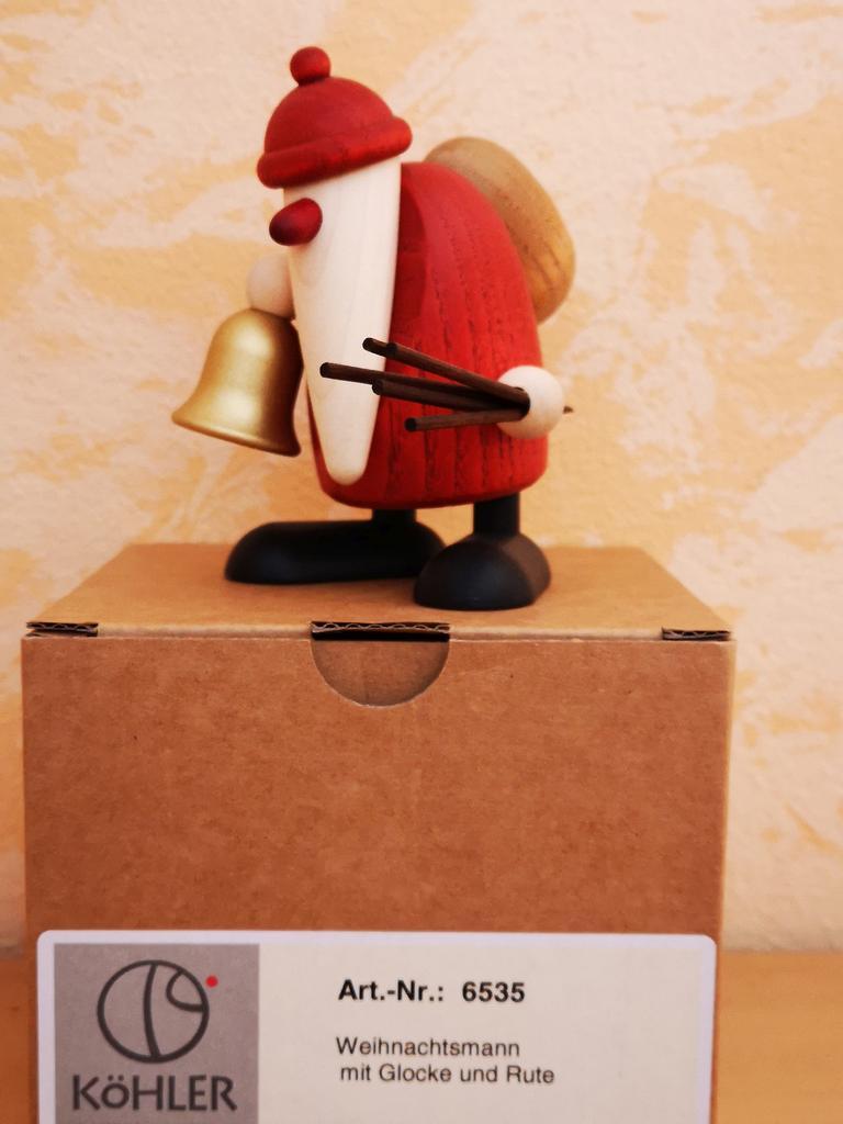 Weihnachtsmann mit Glocke und Rute