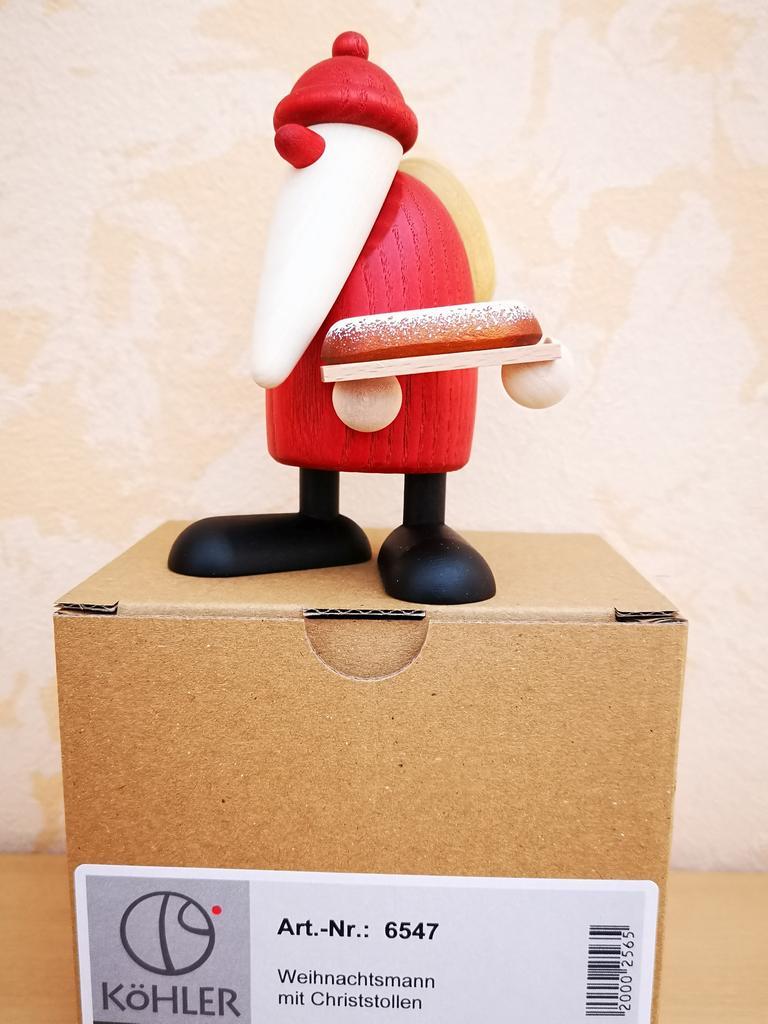 Weihnachtsmann mit Christstollen