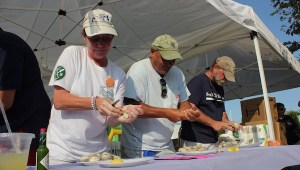 Sag Harborites are expert clam shuckers, as evidenced by this photo from 2017's HarborFest clam-shucking contest. But this August, East Hampton shuckers get their first chance at the spotlight.
