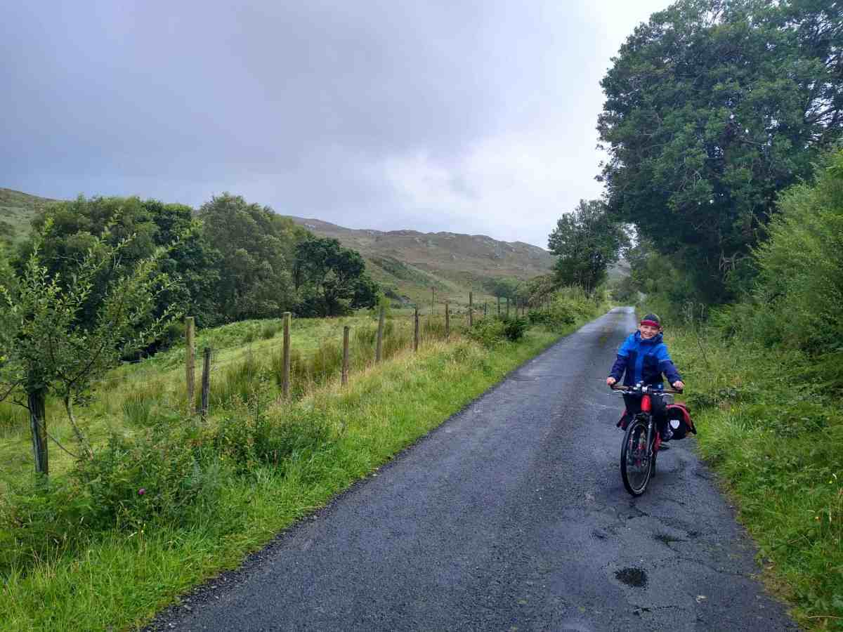 Lush greens, dark grey clouds, quite country road