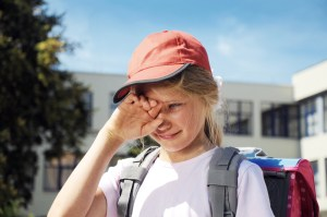 kid crying with backpack on