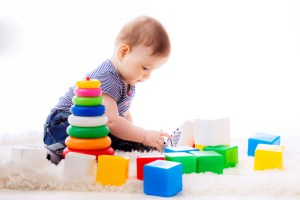 baby playing with colorful cubes