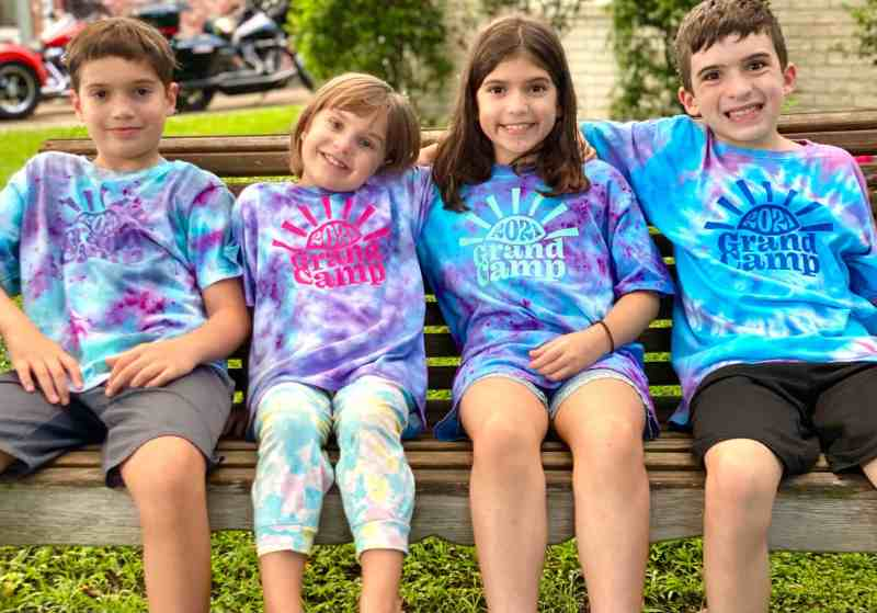 Happy kids in tie dyed shirts