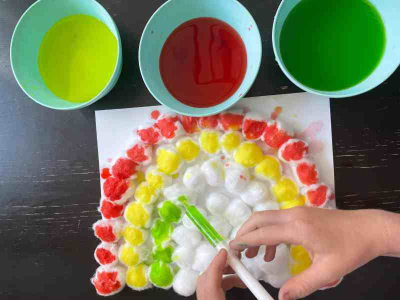 Gluing cotton balls to paper