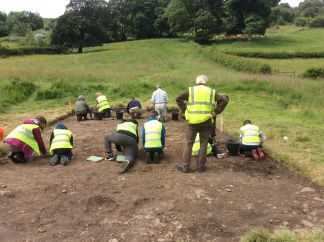 Students from Tommy More's helping to excavate the next layer in Trench 1