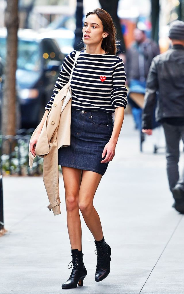 casual striped top with a solid denim skirt