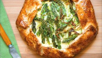 Cheesy Asparagus Galette is a delicious rustic pizza for vegetarian meals. Or, add your favorite protein to beef it up.