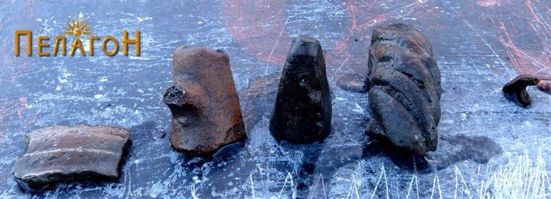 Фрагменти од керамички садови, керамички тег и глава од помал железен клинец