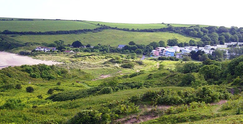 Freshwater Bay Holiday Village nestling in the valley behind Freshwater East beach