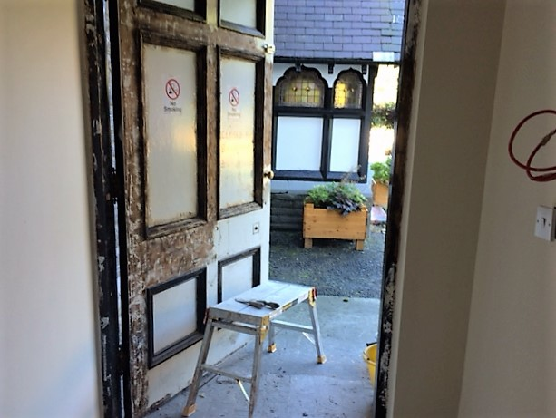 Front door, partly stripped