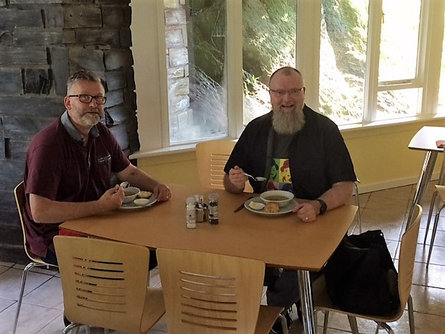 Paul and Shaun enjoying a late lunch of Jane's carrot and lentil soup with cheese scone