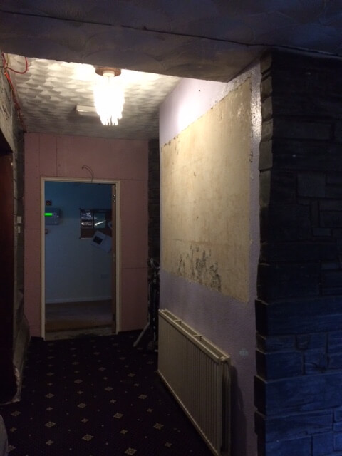 Part of the corridor from teh cafe entrance to the toilets: the wall visible on the right to be demolished as soon as we get the green light