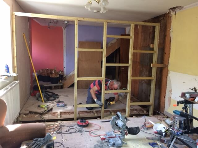 Mike has begun to construct the stud wall which will be the back of the new staircase