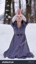 stock-photo-praying-young-girl-in-medieval-dress-74090122