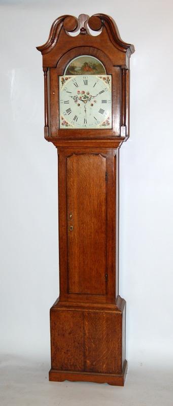 Rare oak clock by Barber Winster