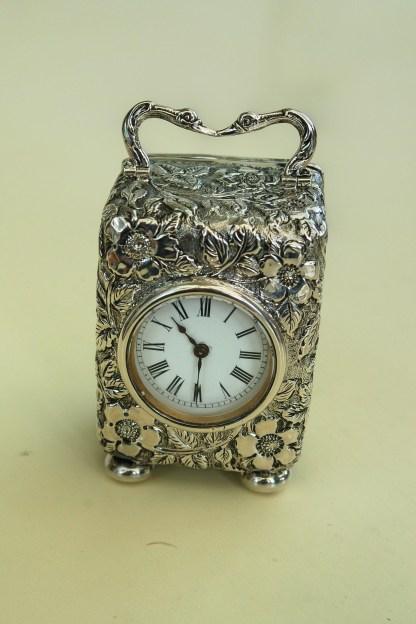 ornate silver carriage clock
