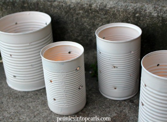 Tin Can Lanterns - penniesintopearls.com - how to make lanterns out of tin cans. Super cheap way to dress up your home inside and outside!